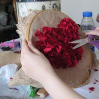 picture of student making rag rug heart