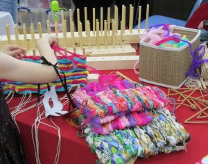 picture of student using peg loom