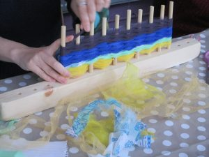 student using one of my peg looms