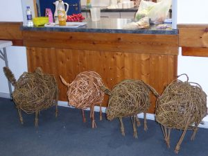 4 willow pig sculptures made by students at my workshop