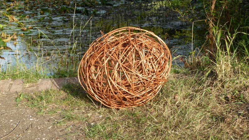 Pic iof large willow egg sculpture by lake