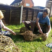 photo of two students making willow deer