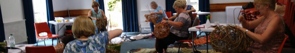 photo of severaal students making willow pig sculpture at workshops