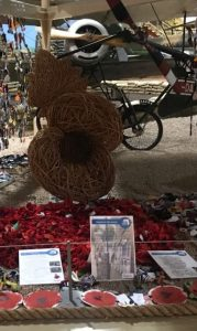 photo of large willow poppy sculpture at exhibition